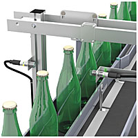 Ultrasonic sensors are used for bottle detection.
