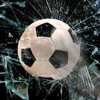 Who kicked the ball and broke the window?