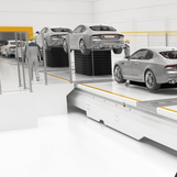 scissor lifts in an automotive production line